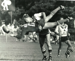 Hubie Abbott, Souths Brisbane, executes a classic driving tackle