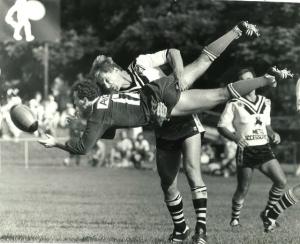 Hubie Abbott, Souths Brisbane, executes a classic driving tackle
