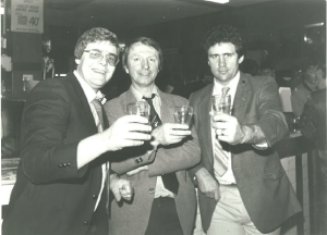 Ray Fletcher (centre) enjoys a XXXX off the wood at Brisbane's Breakfast Creek Hotel in 1984, with Andrew Varley (left) and Steve Ricketts after the British league crew were hosted to lunch at Valleys club, Neumann Oval.
