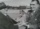 French manager, Antoine Blain receives the symbolic gift of a Kangaroo from Queensland Rugby League president, Vic Jensen during the historic 1951 tour