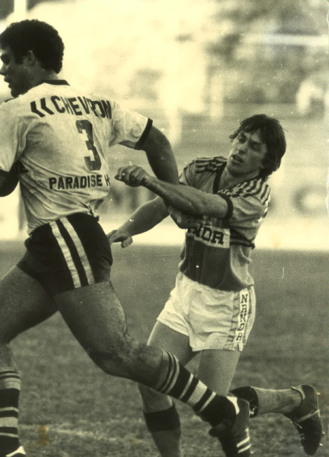 Norths' winger, Shane 'Cocky' McMahon has trouble containing Souths' giant, Mal Meninga in a 1980 club match