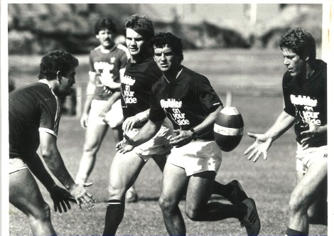 Greg Conescu (centre) at Queensland training with Greg Dowling passing to Wally Fullerton Smith. Mark Murray is on Conescu's right.