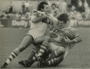 Graham Quinn, playing for St George in Sydney in 1983, tackles Canberra forward, Gary Spears.