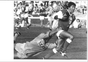 1984 Qld Country rep, Jim Cowell, in action here for North Queensland against Brisbane Brothers, with Brothers' prop, Dave Stafford coming across in cover.