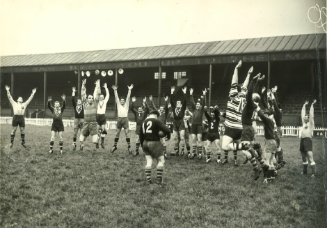 Clive Churchill leads the Australians in a war cry practice during the 1956/57 Kangaroo tour. Photo courtesy of the family of Cyril Connell and the Queensland Rugby League History Committee