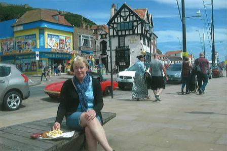 Marie enjoys fish and chips on the beach front at Scarborough.