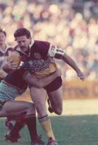 Gene Miles playing for the Brisbane Broncos