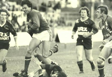 Wynnum-Manly lock, Ian French in a typical rampaging run, on this occasion against Wests at Lang Park in 1981. That's Des Morris on his right. The Wests' player on the left is Peter McDonald, while prop, Brad Rowcliffe watches from the rear. Fullback, Jim Vanderham is the man on the turf.