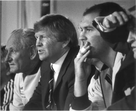 Frank Stanton as coach of the New South Wales State of Origin side in 1984. Legendary trainer, Alf Richards is on his right and prop, Peter Tunks on his left.