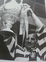 Alex Murphy holds the Challenge Cup aloft after leading Leigh to victory over Leeds at Wembley