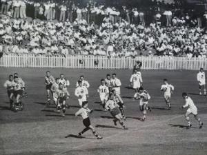Scene from a Brisbane v Toowoomba Bulimba Cup match at the Gabba in the 1950s, with Brisbane on the attack. Photo from the Melit family collection.