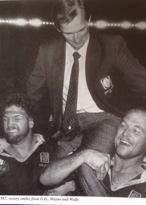 Wayne Bennett chaired from the field by Greg Dowling (left) and skipper, Wally Lewis after the 1987 Origin series triumph.