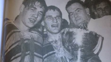 Eric Gelling with teammate, Dennis Manteit and coach, Brian Davies following the 1968 Brisbane grand final win over Easts.