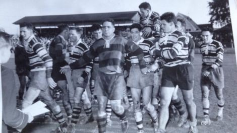 Brothers celebrate their 1956 Brisbane Grand Final win. Captain, Brian Davies is chaired from the field with two try hero, Frank Melit on the far right. Wests' captain, Duncan Hall is i