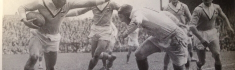 Rene Duffort (France) fends an English rival in Leeds in 1947.